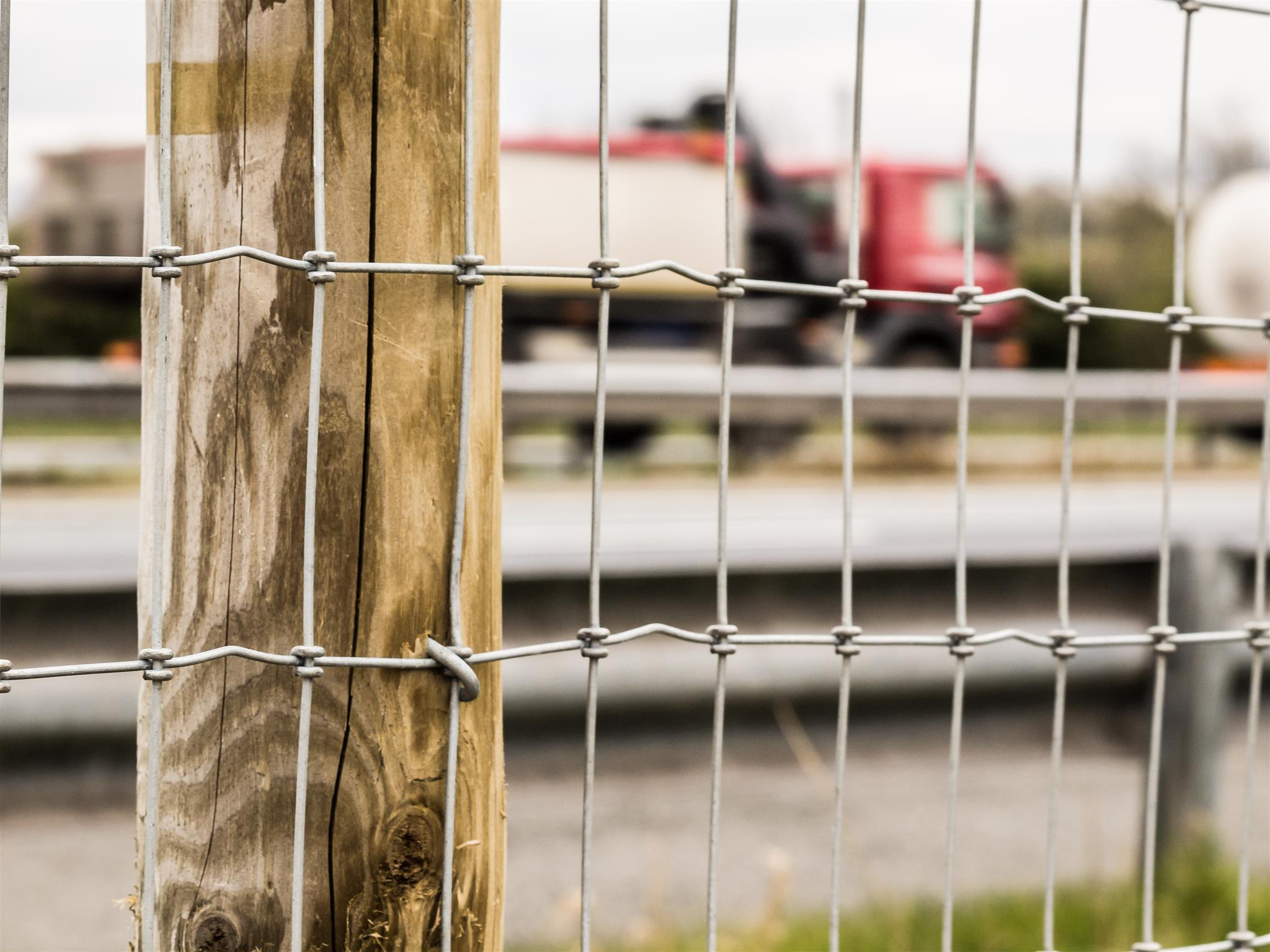 road fencing in front of red lorry