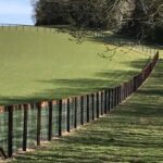 Installed horse fence with timber top rail